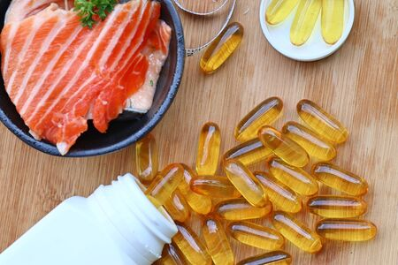 fish oil capsules with fresh Stock Photo