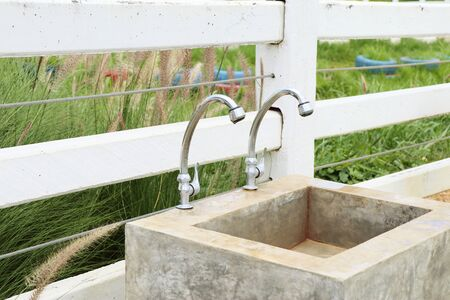 sinks: Faucetc and cement sinks Stock Photo