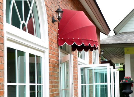 awnings windows: Red awning