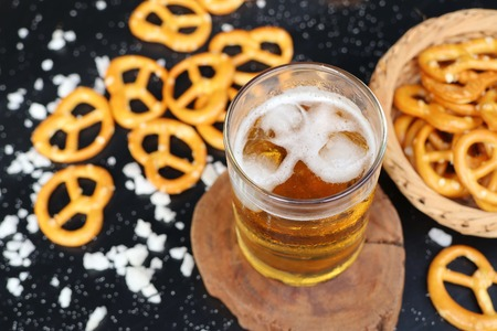 sesame cracker: Salted pretzels with beer Stock Photo