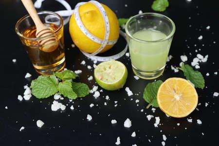 Lemon juice with fresh lime Stock Photo