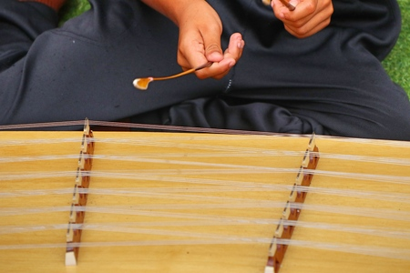 Playing the dulcimer