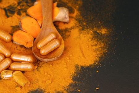 Turmeric capsule with powder Archivio Fotografico