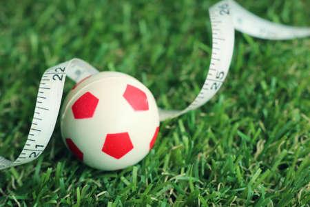 Soccer ball on green field Stock Photo