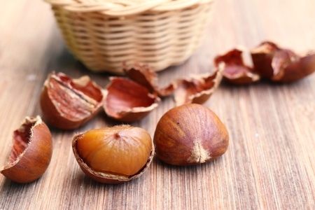 chestnuts seed on wood Stock Photo