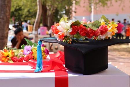 Graduation flowers and hats Stok Fotoğraf