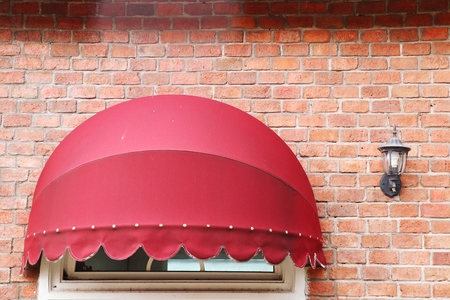 Red awning front store building Foto de archivo