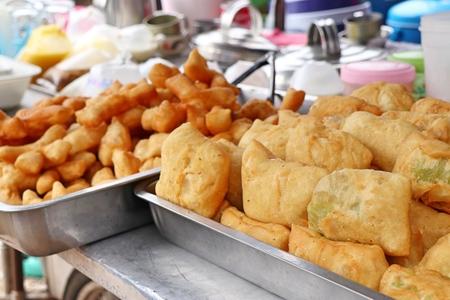 Deep-fried dough stick at market Foto de archivo