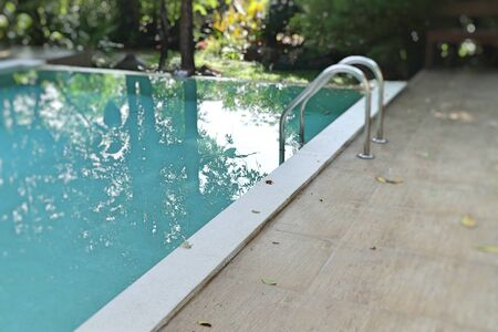 stairs bars ladder in the pool 스톡 콘텐츠 - 124968892