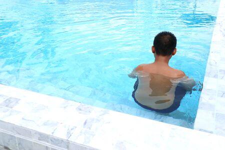 boy swimming in the pool Archivio Fotografico