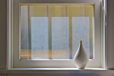 frosted: Vase by the window with soft morning light