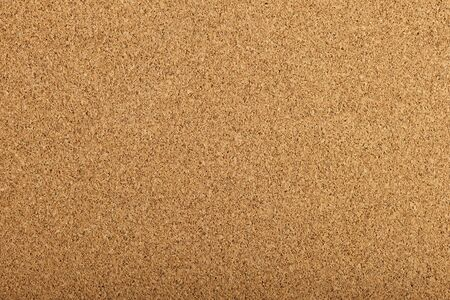 brown corkboard background texture with a fine grain photo