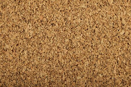 brown corkboard background texture with a large grain photo
