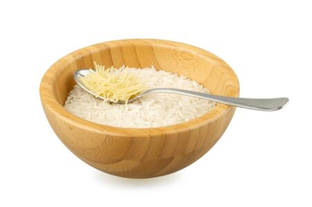 not full: wood bowl with raw rice and spoon with vermicelli isolated on white
