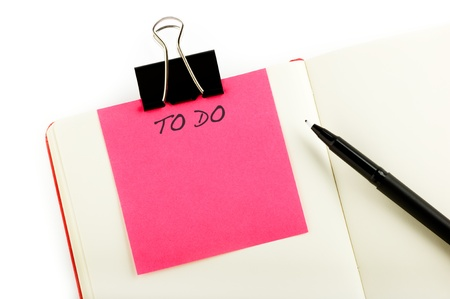 todo: notebook with to-do sticky, pen and clip isolated on white background