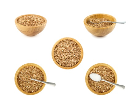 not full: bamboo bowl and steel spoon with buckwheat set isolated on white Stock Photo