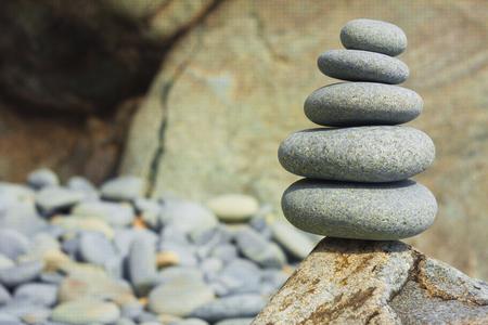rock texture: Five sea stones Balanced on the Rock. Zen stones on rock background Stock Photo