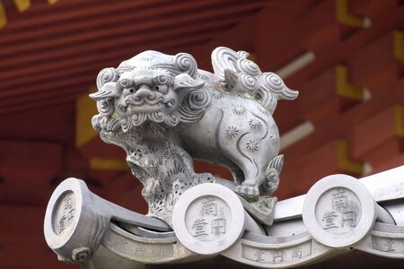 Shishi, mythical lion-dog placed on the roof to scare off evil. Nara japan