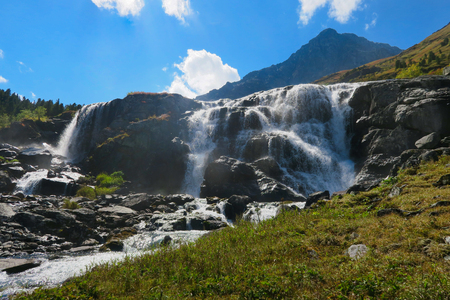 Flowing waterfall in sunny day. Altai mountains, Siberia, Russia Stock fotó