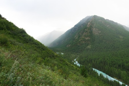 Foggy mountains and river scenic view. Altai Mountains