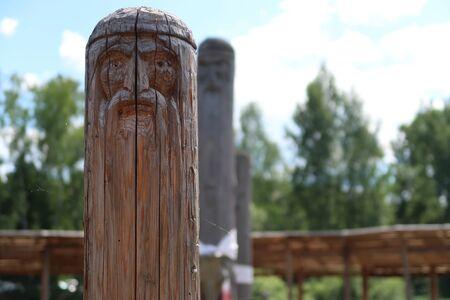 Ancient wooden slavic pagan idol of god. Heathen temple