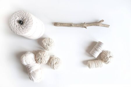 Boho white mockup with cotton yarn on the desk. Top view flat lay. Space for text