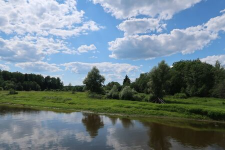 Picturesque river, fields and forest landscape Imagens