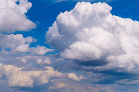 Picturesque heavy fluffy summer clouds. Blue marvelous sky view background. Stock photography. Stok Fotoğraf