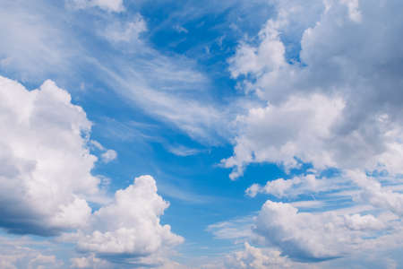 Picturesque white fluffy summer clouds on blue marvelous sky view background. Stock photography. Stok Fotoğraf