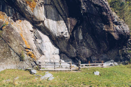 Ancient rock grotto with petroglyphs in the Altai Mountains, Mountain trekking. Russia, Kuylyu grotto
