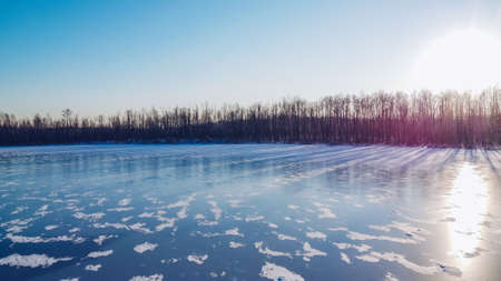 Frozen winter lake ice. Beautiful clear blue ice stock photography. Selective focus, blurred background.