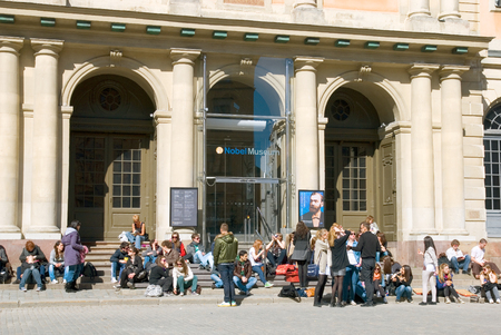 nobel: STOCKHOLM, SWEDEN - APRIL 14, 2010: Visitors near the Swedish Academy on April 14, 2010 in Stockholm. This building also houses the Nobel Library and the Nobel Museum
