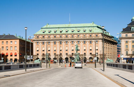 adolf: STOCKHOLM, SWEDEN - APRIL 14, 2010: The building of the Defence Ministry and the monument of Gustav II Adolf.