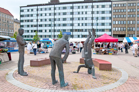 PORI, FINLAND - JULY 6, 2013: Market Square. Market Place Parliament Sculpture Group by Pertti Makinen