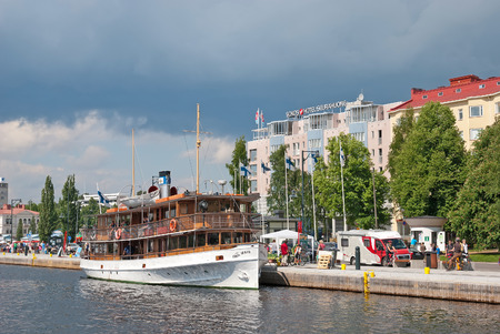SAVONLINNA, FINLAND - JUNE 8, 2013: Passenger Port Matkustajasatama with excursion boats near Market Square. On the background is Original Sokos Hotel Seurahuone