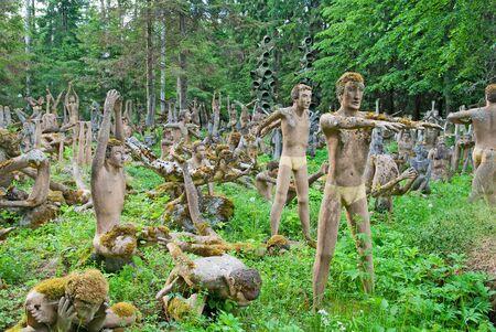 made in finland: KOITSANLAHTI, PARIKKALA, FINLAND - JUNE 8, 2013: Patsaspuisto (Mystical forest). The sculptures of self-taught artist Veijo Ronkkonen (1944-2010) made of concrete and used false teeth from dentists