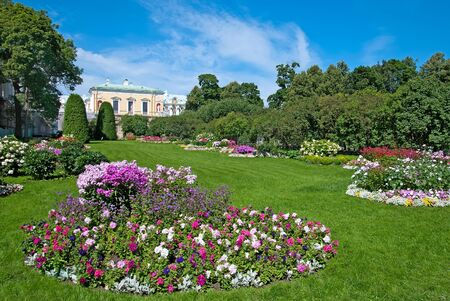 honour: TSARSKOYE SELO, SAINT-PETERSBURG, RUSSIA - JULY  30, 2013: Freylinsky garden (Maids of Honour Garden). On the background is The Cold Bath Pavilion. The Tsarskoye Selo is State Museum-Preserve Editorial