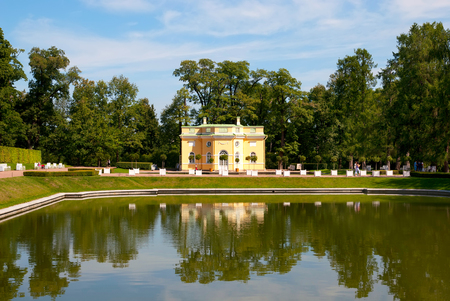 bathhouse: TSARSKOYE SELO, SAINT-PETERSBURG, RUSSIA - JULY  30, 2013: The Upper Bathhouse Pavilion and Mirror Pond in Catherine Park. The Tsarskoye Selo is State Museum-Preserve and located near Saint-Petersburg