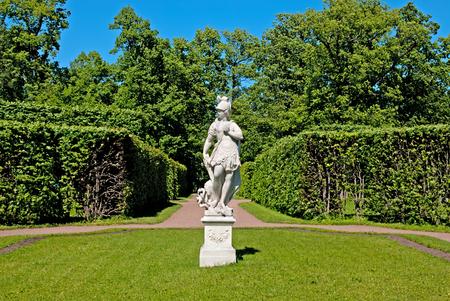 allegory: TSARSKOYE SELO SAINT PETERSBURG RUSSIA JUNE 2015: Catherine Park with Sculpture Allegory of Wisdom trampling on Vice. The Tsarskoye Selo is State Museum Preserve. Located near Saint Petersburg Editorial