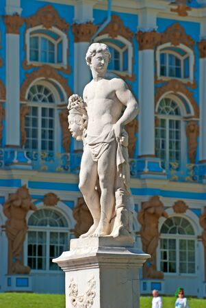 heads old building facade: TSARSKOYE SELO SAINT PETERSBURG RUSSIA JUNE 2015: Perseus Statue and the Catherine Palace on the background. The Tsarskoye Selo is State Museum Preserve. Located near Saint Petersburg Editorial