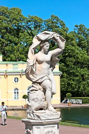 TSARSKOYE SELO SAINT PETERSBURG RUSSIA JUNE 2015: The Galatea sculpture in the Catherine Park. On the background is Upper Bathhouse Pavilion. The Tsarskoye Selo is State Museum Preserve