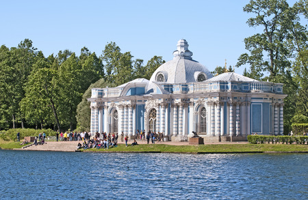 selo: TSARSKOYE SELO SAINT PETERSBURG RUSSIA JUNE 2015: People near the Grotto Pavilion near Great Pond in the Catherine Park. The Tsarskoye Selo is State Museum Preserve