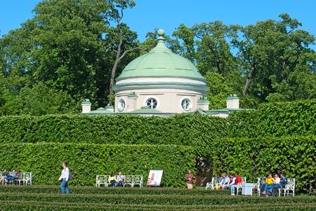 bathhouse: TSARSKOYE SELO SAINT PETERSBURG RUSSIA JUNE 2015: People sit on the benches near the Lower Bathhouse Pavilion in Catherine Park. The Tsarskoye Selo is State Museum Preserve