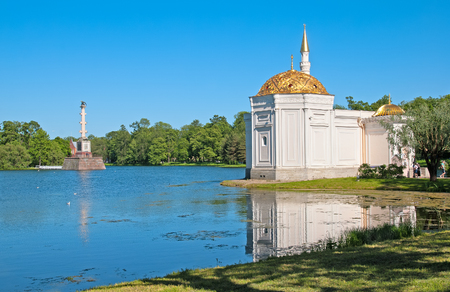 turkish bath: TSARSKOYE SELO SAINT PETERSBURG RUSSIA JUNE 2015: The Turkish Bath Pavilion on the bank of the Great Pond in the Catherine Park. Left side is Chesme Column