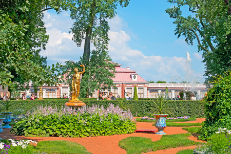 bacchus: PETERHOF, SAINT-PETERSBURG, RUSSIA - JULY 22, 2014: Monplaisir Garden and Bacchus with Satyr Sculpture in The Eastern Part of The Lower Park. On the background is Monplaisir My Pleasure Palace