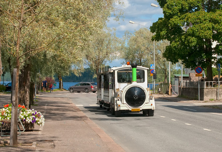 excursion: LAPPEENRANTA, FINLAND - AUGUST 8, 2016: Excursion Fun Train on the one of the streets near Saimaa Lake Editorial