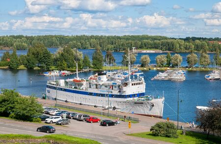 LAPPEENRANTA, FINLAND - AUGUST 8, 2016: Summer landscape with white boat in Lappeenranta Harbor on Saimaa Lake. View from Linnoitus Fortress