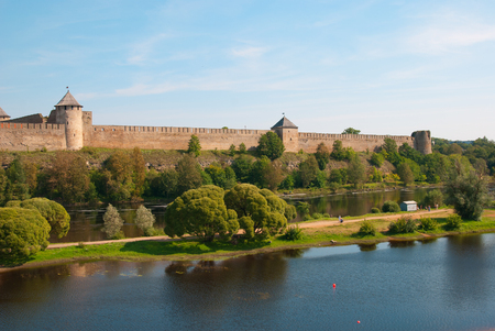 IVANGOROD, RUSSIA - AUGUST 21, 2016: Ivangorod Fortress. Was built in 1492. View from Narva Town in Estonia. Foreground is Joaoru Island in The Narva (Narova) River on Estonian side Editorial