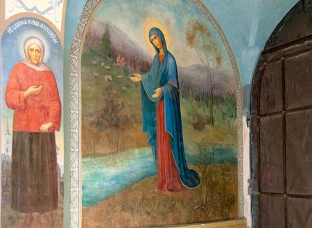 ida: KUREMAE, IDA-VIRUMAA COUNTY, ESTONIA - AUGUST 21, 2016: Icon Mother of God Puhtitsa ( Near The Source ) and Xenia of St Petersburg Icon Saint Gate with belfry Puhtitsa Dormition Convent .. Editorial