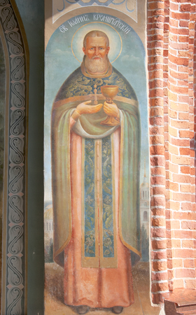 ida: KUREMAE, IDA-VIRUMAA COUNTY, ESTONIA - AUGUST 21, 2016: John of Kronstadt Icon in the arch of The Saint Gate with belfry. Puhtitsa Dormition Convent of Russian Orthodox Church